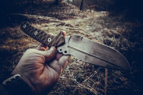 Bushcraft vs survival knife, a knife held in a hand