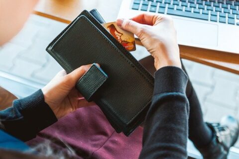 Why are money important in a survival kit, wallet and a card